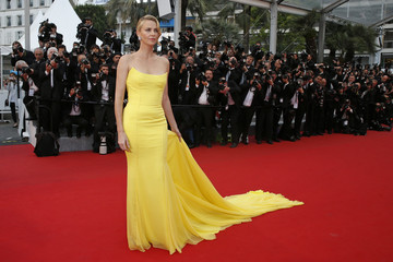 "Cast member Charlize Theron poses on the red carpet as she arrives for the screening of the film ""Mad Max: Fury Road"" out of competition at the 68th Cannes Film Festival in Cannes"