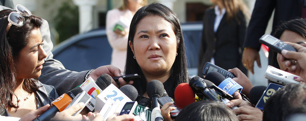 Peru's presidential candidate Keiko Fujimori speaks to the media after a meeting with Mexican President Felipe Calderon in Lima