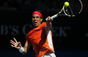 Nadal returns a shot against Karlovic at the Australian Open tennis tournament in Melbourne