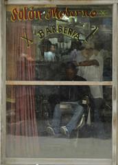 A barber works in a saloon in Havana