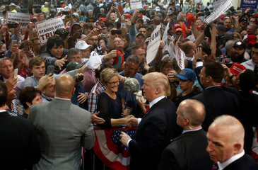 Republican U.S. presidential candidate Donald Trump signs autographs at the end of a campaign rally in Eugene, Oregon, U.S.