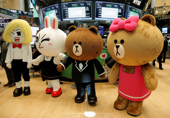 Line characters pose for photos during the company's IPO on the floor of the NYSE