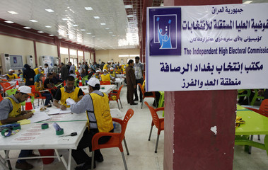 Independent High Electoral Commission (IHEC) employees count votes at an analysis centre in Baghdad