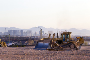 Las Vegas Strip casinos are seen in the background as earth movers prepare the desert for new homes in Las Vegas