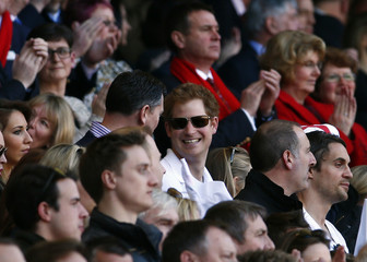 Britain's Prince Harry smiles during England's Six Nations international rugby union match against Wales at Twickenham in London