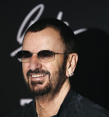 Ringo Starr gestures as he is interviewed during a ceremony where the former Beatle celebrated his 70th birthday at the Hard Rock Cafe in New York