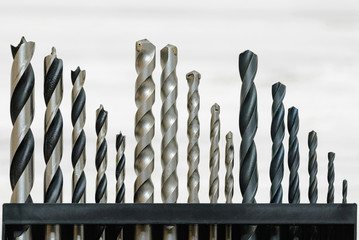 A full set of drill bits intended for metal, masonry and wood works in different sizes.