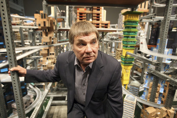 Chris Burden stands next to his large-scale kinetic sculpture, Metropolis II, as it is previewed to the press at the Los Angeles County Museum of Art (LACMA) in Los Angeles, California January 11, 2012.