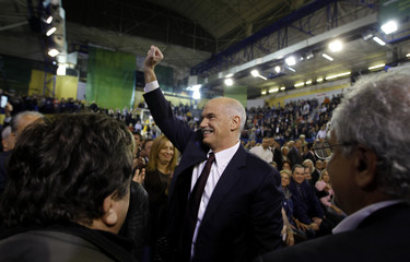 Greek PM Papandreou waves to supporters during a pre-election rally in Athens
