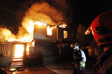 Firefighters work to put out a fire in Valparaiso city