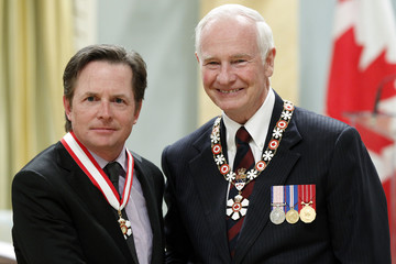Actor Fox stands with Canada's GG Johnston after he was awarded the rank of Officer in the Order of Canada at Rideau Hall in Ottawa