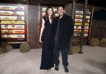 """Cast member Sandler and his wife pose at the premiere of """"The Ridiculous 6"""" in Universal City"""