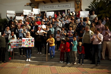 People take part in a protest in rejection to the Paris and Mali attacks and the attacks worldwide, in Arroyo de la Miel