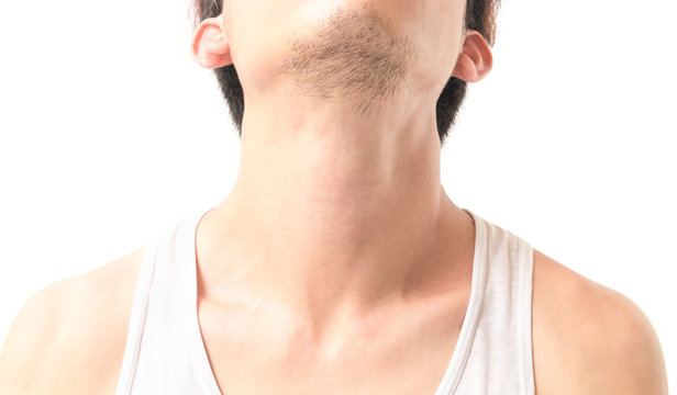 Yong man show neck on white background, pain concept