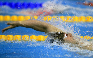 Rogan of Austria competes at the men's 200 m individual medley heats during the 2012 European Swimming Championships in Debrecen
