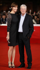 Actor Richard Gere and his wife Carey Lowell pose during a red carpet at the Rome Film Festival