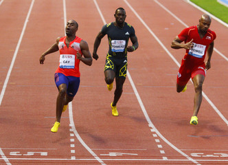 Gay of the U.S., Ashmeade of Jamaica and Powell of Jamaica compete in the 100m event of the Lausanne Diamond League meeting in Lausanne