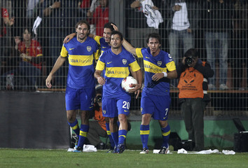 Players of Argentina's Boca Juniors celebrate after Isaurraldes scored a goal against Chile's Union Espanola during their Copa Libertadores soccer match in Santiago