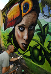 "An artist participates in the ""Graffest"" street art and graffiti animation festival in St. Petersburg"
