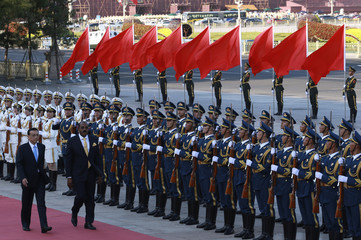 Chinese Premier Li Keqiang and Prime Minister of Antigua and Barbuda Gaston Browne inspect honour guards during a welcoming ceremony outside the Great Hall of the People in Beijing