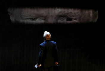 "A Mexican comic looks at the projected face of U.S. Republican presidential candidate Trump, during a show entitled ""Sons of Trump"" that pokes fun at the candidate at the Aldana theater in Mexico City"