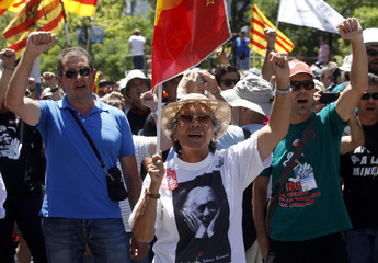 Supporters of miners protest against government austerity measures in Madrid