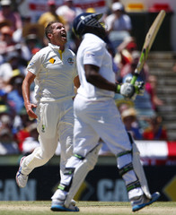 Australia's Siddle reacts to a high ball hit by England's Carberry during the second day of the third Ashes test cricket match in Perth