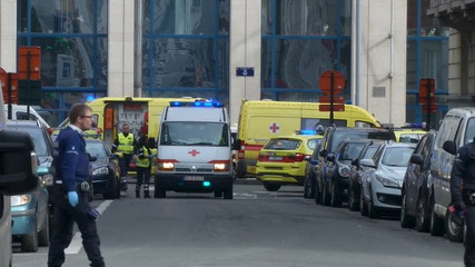 Still image taken from video of emergency personnel seen at the scene of a blast outside a metro station in Brussels