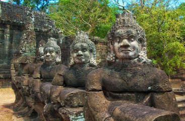 Statues in the entrance to the ancient city of Bayon in the Angkor Wat temple complex near Siem Reap, Cambodia
