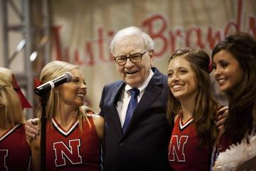 Warren Buffett sings with University of Nebraska cheerleaders during the Berkshire Hathaway Annual shareholders meeting in Omaha