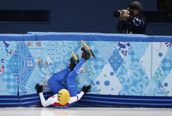 Katerina Novotna of the Czech Republic crashes out during the women's 1,000 metres short track speed skating heats event in the Iceberg Skating Palace at the Sochi 2014 Winter Olympic Games