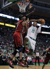 Boston Celtics forward Glen Davis drives against Miami Heat's Jermaine O'Neal and Michael Beasley during  their NBA Eastern Conference basketball playoff series in Boston