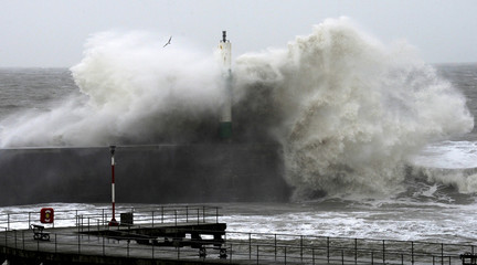 Large waves crash over the jetty at Aberystwyth in mid Wales