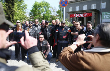 Members of the motorcycle group called Night Wolves and their supporters coming from Russia, Macedonia, Bulgaria and Germany pose for a picture near the German-Russian museum Berlin-Karlshorst in Berlin