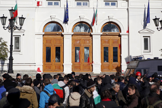 Paint is splashed on the entrance of the parliament building during a protest by students in Sofia