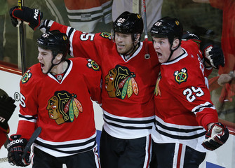 Chicago Blackhawks' Bickell celebrates scoring the game winning goal against the Minnesota Wild with teammates during overtime of Game 1 at their NHL Western Conference Quarterfinals hockey game in Chicago, Illinois