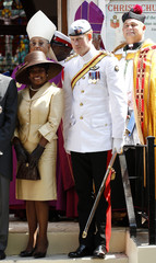 Britain's Prince Harry and Joan Foulkes, wife of the Bahamas Governor General, leave a service at Christ Church Cathedral in Nassau
