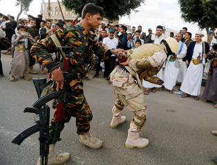 Houthi militants perform the scene depicting a fake detention of a U.S. soldier during a demonstration against the U.S. intervention in Yemen, in the country's capital Sanaa