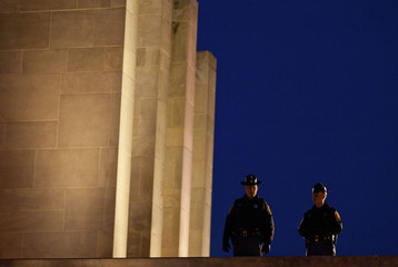 Two police officer look over the campus before a memorial service for Virginia Tech police officer Deriek W. Crouse on the campus of Virginia Tech in Blacksburg