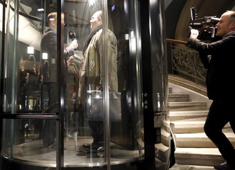 Swiss People's Party ministerial candidate Norman Gobbi talks to media in an elevator in the Swiss Parliament in Bern
