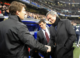 Real Madrid's Mourinho and Mallorca's Laudrup greet during their Spanish first division soccer match in Madrid