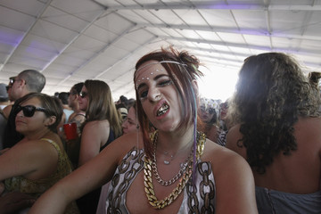 Concert-goer Bella Boom Box reacts during the performance by hip hop artist 2 Chainz during the Coachella Music Festival in Indio, California