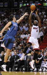 Miami Heat forward LeBron James is defended by Minnesota Timberwolves Darko Milicic of Serbia in their NBA game in Miami