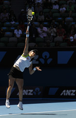 Clijsters of Belgium serves to Azarenka of Belarus during their semi-final match at the Australian Open in Melbourne