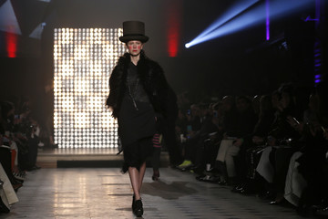A model presents a creation by British designer Vivienne Westwood as part of her Fall/Winter 2014-2015 women's ready-to-wear collection during Paris Fashion Week