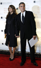 Actor Clooney and Canalis attend the Robert F. Kennedy Center for Justice & Human Rights Ripple of Hope awards dinner in New York