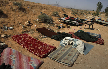 Sleeping pads abandoned by government army soldiers are seen at a checkpoint after rebels overran their position in the village of Hawamid
