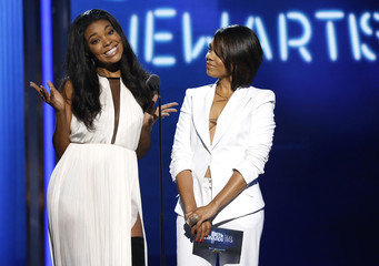 Presenters Union and Hall announce the best new artist award during the 2014 BET Awards in Los Angeles