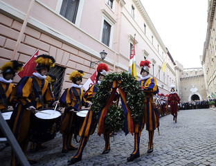 Swiss guards march during a ceremonyto pay tribute to their compatriots who died during the Sack of Rome at the Vatican