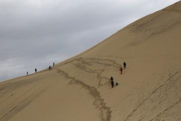 People walk along Dune du Pilat  in La Teste de Buch